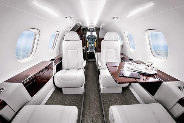 https://www.aerojetme.com/wp-content/uploads/2020/11/phenom-300-interior.jpg